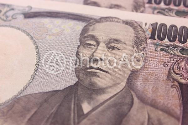 一万円札のアップの写真