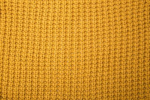 全面 編み物 編物 毛糸 毛糸玉 糸 けいと 手芸 編み物用品 手編み ニット 編む 手作り 手仕事 ハンドメイド 趣味 ホビー 素材 資材 シンプル 雑貨 1色 一色 接写 アップ 編み目 編み地 編地 からし色 カラシ色 辛子色 山吹色 やまぶき色 黄土色 茶色 黄色 生地