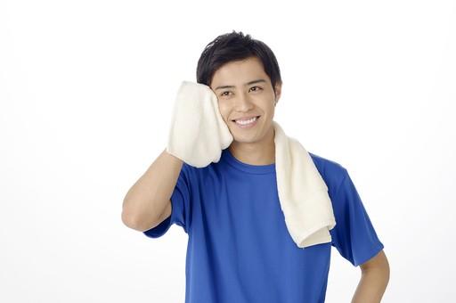 汗を拭く人
