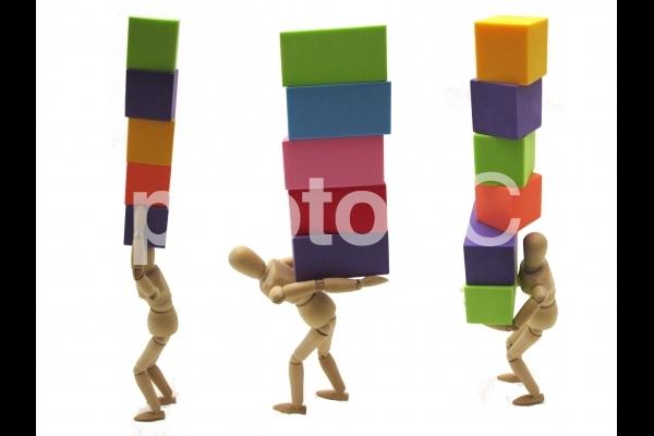 重税 重荷のイメージの写真