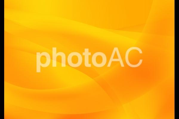 オレンジの流線型抽象背景素材の写真