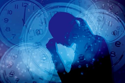 ストレスを抱える女性と時間-青背景の写真