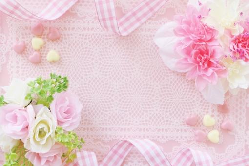 花とリボンのフレームの写真