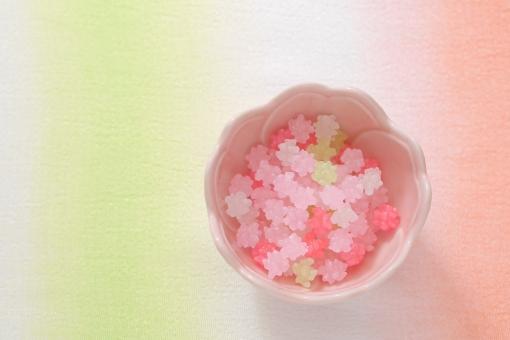 こんぺいとう コンペイトウ 金平糖 お菓子 砂糖菓子 和菓子 さくら色 桜 桜色 布 和 和風 ちりめん 生地 サクラ ピンク 緑 白 壁紙 砂糖 食べ物 春 小物 雑貨 和柄 背景 雛祭り ひな祭り ひなまつり 桃の節句