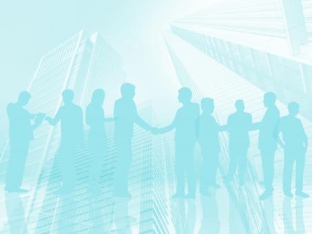 ビジネスマンの契約成立の握手とパステルトーン青のオフィス街背景の写真