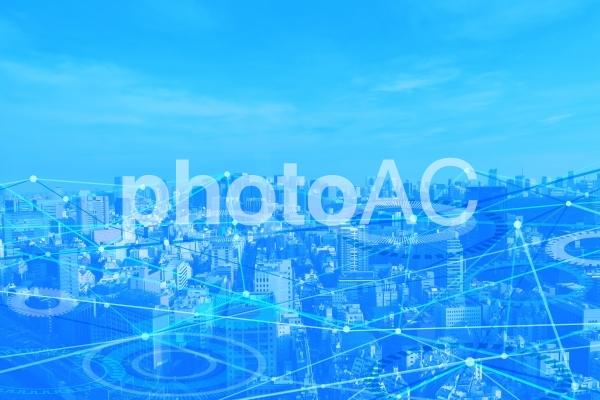 ネットワークテクノロジー街並み青背景素材の写真