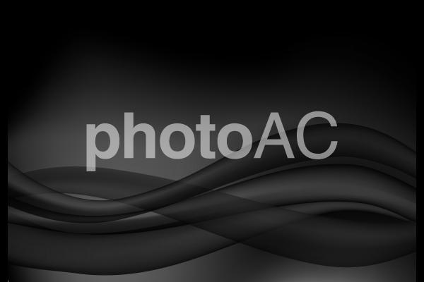 黒の流線型抽象背景素材の写真
