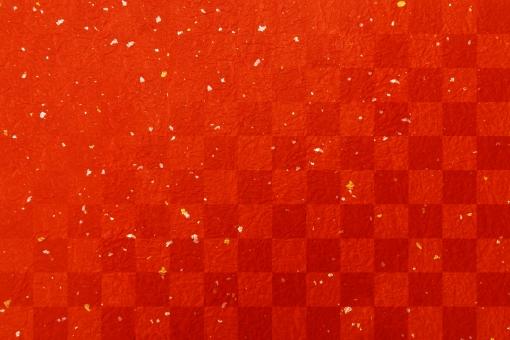 市松模様の赤い和紙金銀箔テクスチャ背景素材の写真