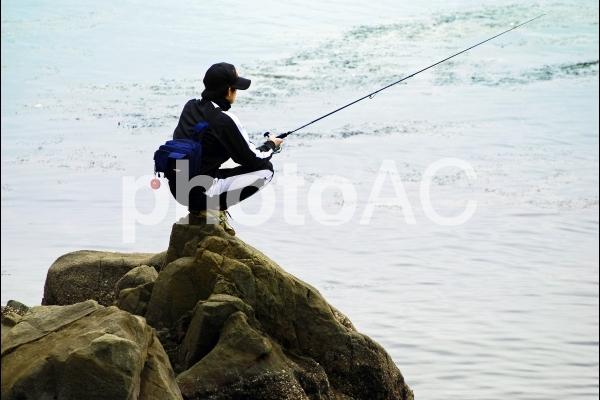 ひとりぼっちの釣り人の写真