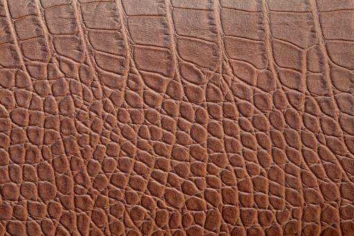 革 皮 レザー 茶色 ブラウン アップ クローズアップ なめし皮 背景 背景素材 背景イメージ バックグラウンド 動物 爬虫類 ワニ 蛇 ヘビ 模様 デザイン パターン 素材 イメージ 材料 質感 テクスチャ テクスチャー 荒い 表皮 表面 着色 合成樹脂 クロコダイル 一面 全面 壁紙 スタジオ スタジオ撮影