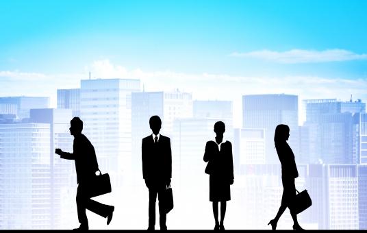 ビジネスイメージ オフィス街と働く人々の写真