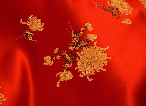 布 生地 中国 中国風 中華 中華風 チャイナドレス 絹 シルク サテン レーヨン ポリエステル 化学繊維 刺繍 花 植物 模様 柄 繊維 光沢 アジア 素材 背景 バックグラウンド テクスチャ 赤