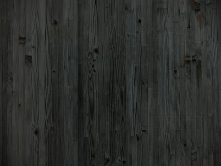 黒い木目テクスチャ背景素材の写真
