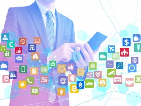様々なアプリを取り扱うビジネスマン-白背景の写真