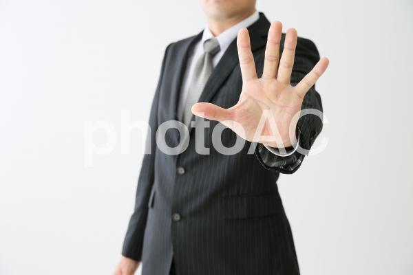 拒否するビジネスマンの写真