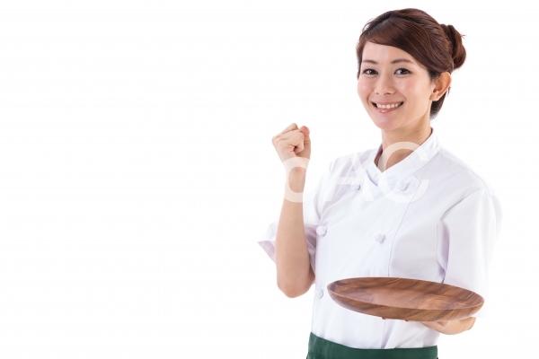 飲食店 女性店員ガッツポーズの写真