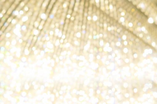 金色のキラキラ輝き抽象背景素材の写真