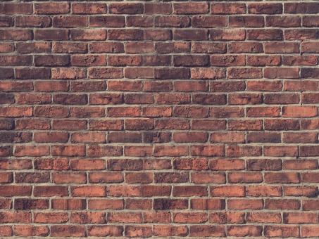 ヴィンテージ感溢れるレンガの壁・背景素材の写真