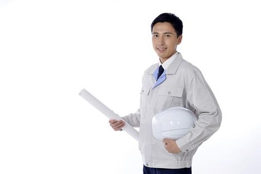日本人 男性 おとこ 青年 社員 職員 ビジネスマン 仕事 労働 業務 ビジネス ワーク 会社 職場 営業 事務 作業 制服 上半身 笑顔 ヘルメット 書類 図面 持つ 携える 設計 点検 検査 監督 担当 防護 安全 派遣 現場 白バック 白背景 mdjm001