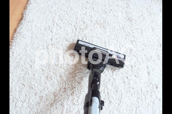 カーペットと掃除機の写真