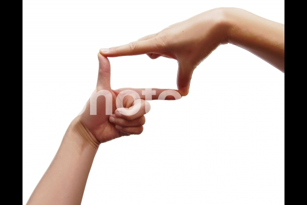 手のしぐさ 指フレームの写真