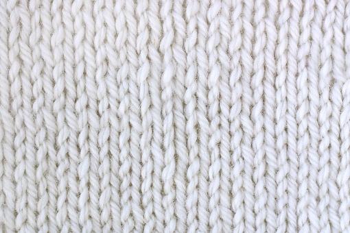 背景 テクスチャ 冬 ニット 毛糸 セーター 編み目 模様 編み物 あみもの メリヤス編み 白 生地 服