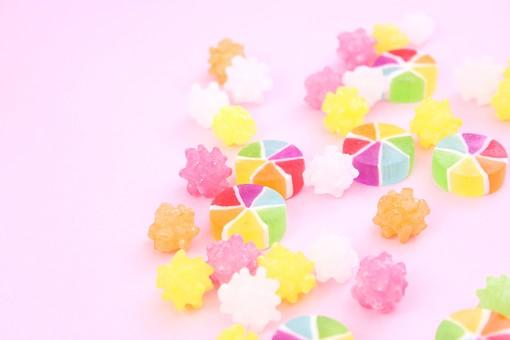 ひなまつり ひな祭り 和 和のイメージ 和紙 ピンク かわいい 風車飴 コンペイトウ 金平糖 こんぺいとう ドロップ ベビードロップ 飴 カラフル 丸い 和菓子 お菓子 お花 背景 バレンタイン 甘い キャンディー