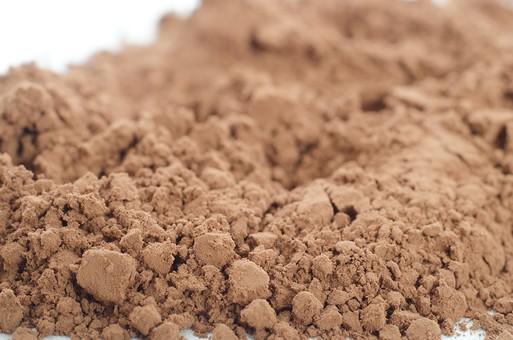 粉 粉末 粉体 パウダー 固まり かたまり 固まった かたまった 集まり 集まった 集合 まとまり まとまった ぼかし ぼける ぼやける ぼやけた 覆う 覆われた 茶色 土色 ブラウン ライトブラウン 褐色 不定形 シナモンパウダー ココアパウダー