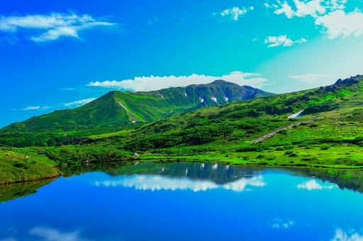 天空の旭岳の写真