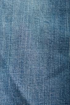 ジーンズ ジーパン Gパン デニム 背景 無地 生地 布 布地 擦れ スレ ファッション 服装 服 スボン 切り口 切口 洋裁 青 ブルー 平ら 平面 パンツ しわ ジージャン Gジャン 裁縫