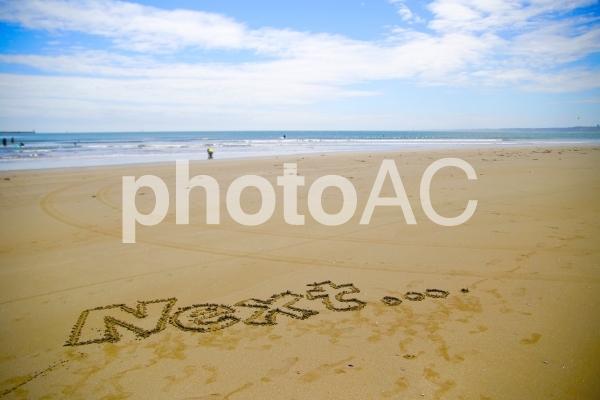 砂浜に書いたNext...の写真