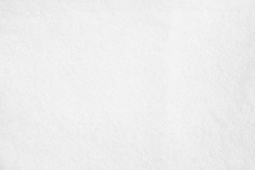 白いフェルト素材の背景テクスチャー(高解像度)の写真