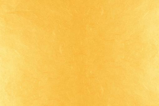 オレンジの和紙テクスチャ背景素材の写真