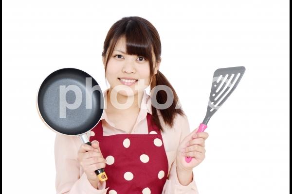 エプロン姿の女の子の写真