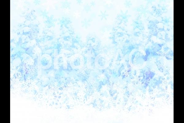 神秘的な冬の青い森と雪の結晶の写真