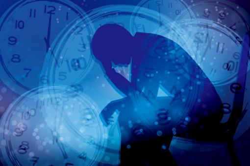ストレスを抱える男性と時間-青背景の写真