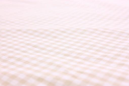 布 織物 チェック 格子 生地 綿 木綿 背景 背景素材 バック パターン バックグラウンド テーブルクロス 柄 模様 テクスチャ テクスチャー 素材 壁紙 テキスタイル 布地 チェック柄 ギンガムチェック カジュアル ナチュラル ベージュ 肌色 茶色 ブラウン しわ ドレープ