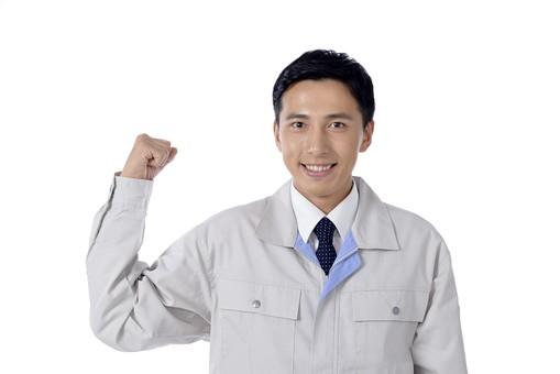 日本人 男性 おとこ 青年 社員 職員 ビジネスマン 仕事 労働 業務 ビジネス ワーク 会社 職場 工場 オフィス 事業 営業 事務 作業 制服 笑顔 右腕 ガッツポーズ 拳骨 こぶし 元気 やる気 力 パワー エネルギー がんばる 応援 自信 自慢 白バック 白背景 mdjm001