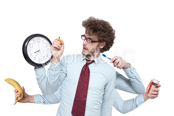 時間に追われる男性の写真