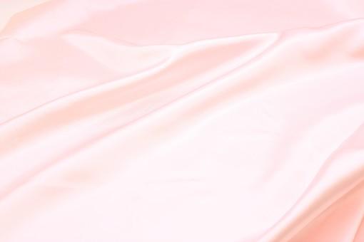 布 織物  生地  背景 背景素材 バック  バックグラウンド テーブルクロス  素材 テクスチャ テクスチャー 壁紙  布地 無地     ピンク色 ピンク ドレープ しわ サテン 光沢 滑らか 艶 ツヤ つるつる サテン生地 シルク 高級感