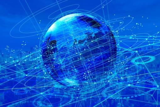 光の青いネットワークテクノロジー地球と街並み背景の写真