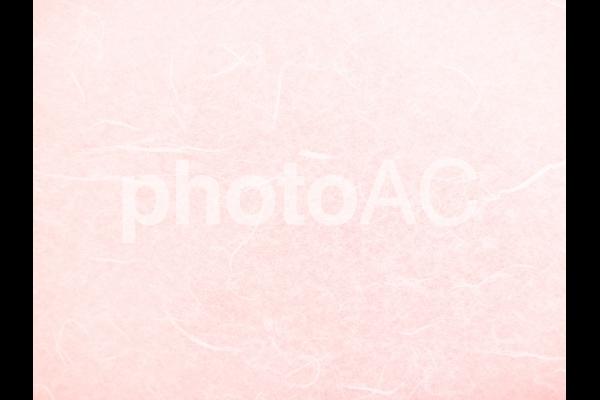 ピンクの和紙テクスチャ背景素材の写真