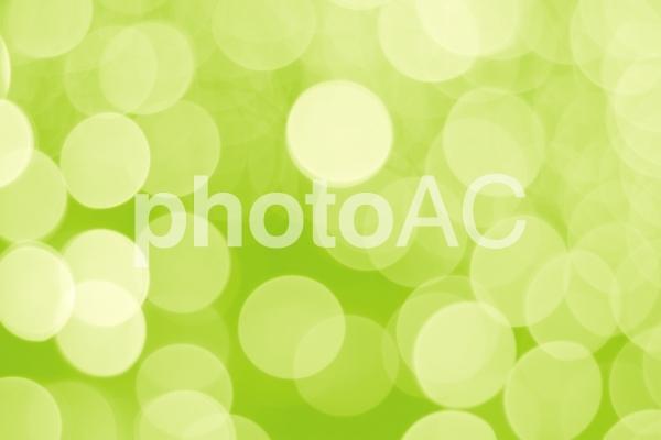 黄緑色のキラキラ背景の写真