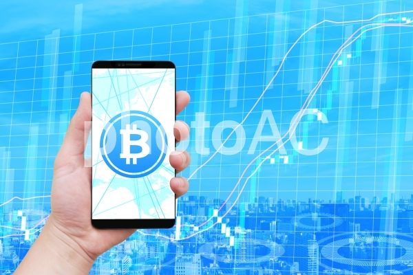 ビットコイン仮想通貨とスマートフォンとチャートの写真