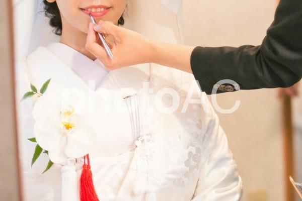 紅を引く花嫁の写真