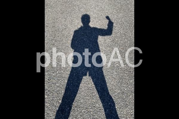 人物シルエット力こぶの写真
