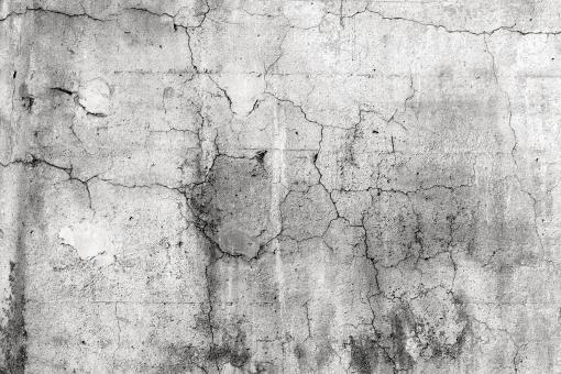 ひび割れコンクリート塀の背景の写真