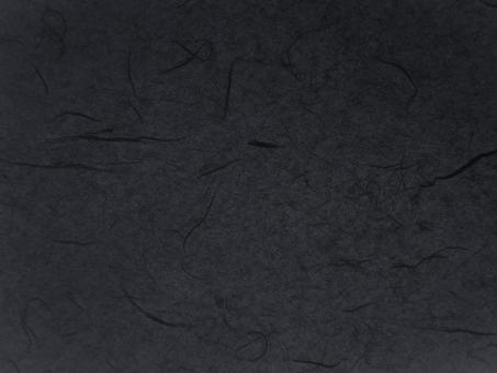 黒の和紙テクスチャ背景素材の写真