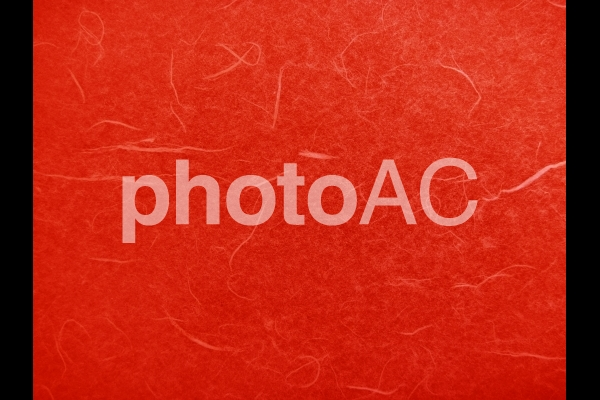 赤の和紙テクスチャ背景素材の写真